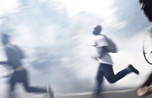 Protestors Run Through A Cloud Of Tear Gas During A Demonstration In Dakar