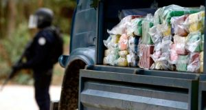 Senegalese Policeman Stands In Front Of A Truck Loaded With Cocaine To Be Destroyed Just Outside The Capital Dakar